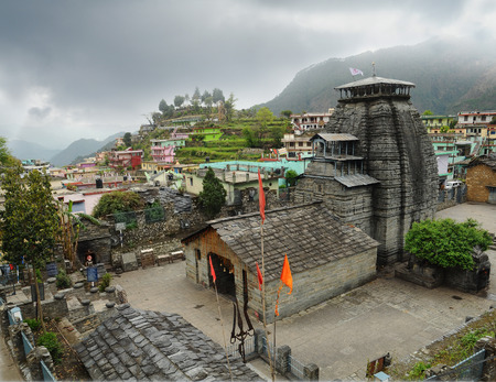 hindu god: Ancient temple of Lord Shiva and rarity trident in the Gopeshwar town in Himalaya Stock Photo