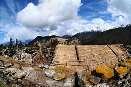 Primitive stone houses Indian shepherds in the Himalayas. Uttarakhand. India