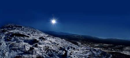 View of a Petros peak mountain on background sun. Chornohora ridge in eastern Carpathians.