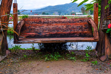 Large wooden seats with nature behind