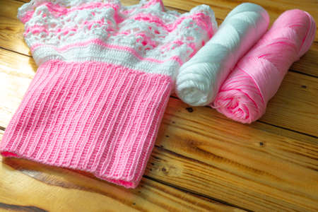 White and pink yarn and excellent work from knitting.
