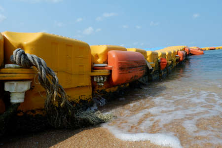 Buoys that stick out to the sea. Imagens