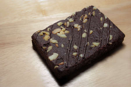 Healthy Chocolate brownies on wooden plate