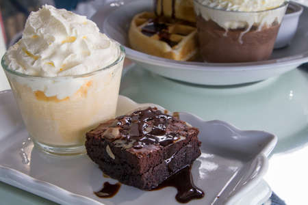 Slice of Dark Chocolate Peanut Brownie serve with Vanilla ice cream