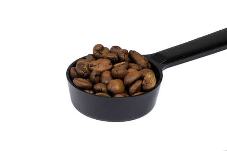 Close up on Full of Roasted Coffee Beansin the spoon isolate on white background Stok Fotoğraf