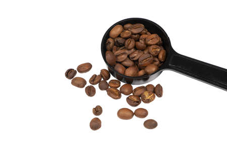 Fully Roasted Coffee Beans in the spoon  isolate on white background