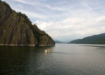 A view of Vidraru lake located on the Arges river, Romania photo