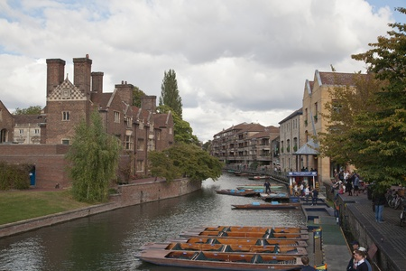 cambridgeshire: View of the river Cam in Cambridge complete with iconic punts tied at the side of the river waiting to hired  Editorial