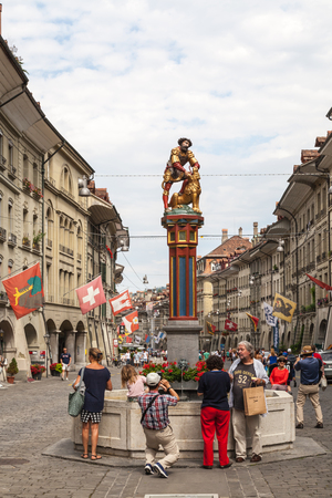 Street view on Kramgasse in the old town of Berne city. Kramgasse is a popular shopping street and medieval city center of Bern, Switzerland