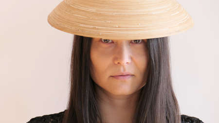 Asian mature woman with Hat