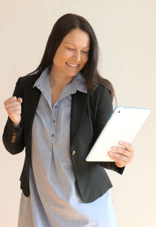 Happy Asian business woman with tablet