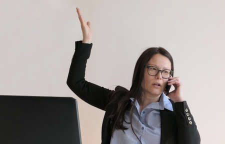 Asian woman working in office with stress