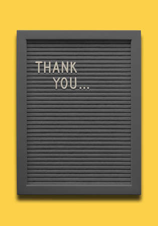 Black message board Thank you on the yellow background Standard-Bild