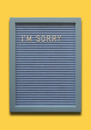 Light blue message board I`m sorry on the yellow background Banco de Imagens