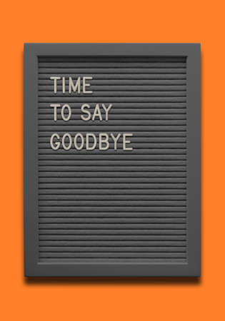 Black message board Time to say goodbye on the orange background