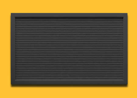 Empty black message board on the yellow background