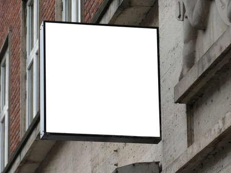 Blank square signboard on the wall Standard-Bild