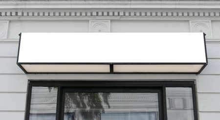 Blank rectangular signboard on the wall