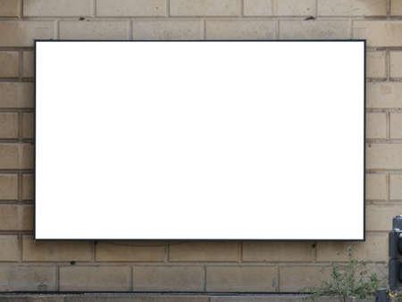 Big blank billboard on the building in the walking street in Copenhagen