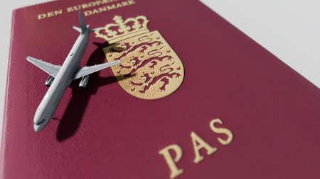Danish passport and airplane