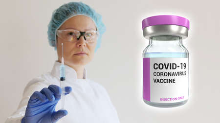 Nurse with injection in hand and coronavirus vaccine dose