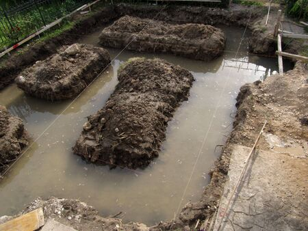 Channels for foundations of the house filled with water