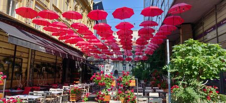 Red umbrellas on the street in Belgrade- Serbia.