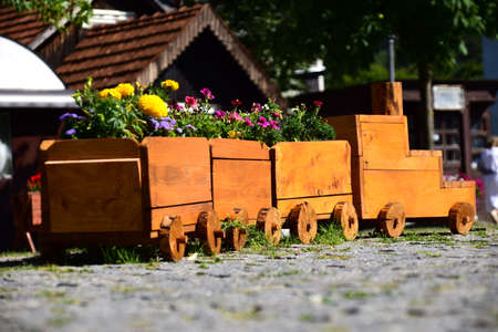 Wooden train with flowers. Tourist attraction. Photo taken in Kolasin, Montenegro.