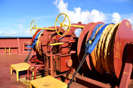 Mooring winches on forward station on cargo ship. Concept for maritime industry publications. Banque d'images