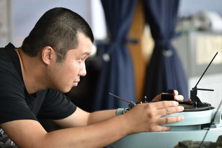 Young seaman making observation of a celestial body. Routine jobs for navigational officers.