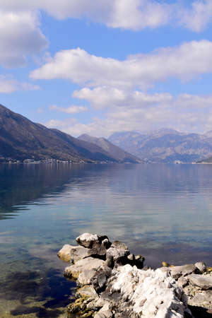 Beautiful Bay of Boka Kotorska. Blue sky and calm clear water.