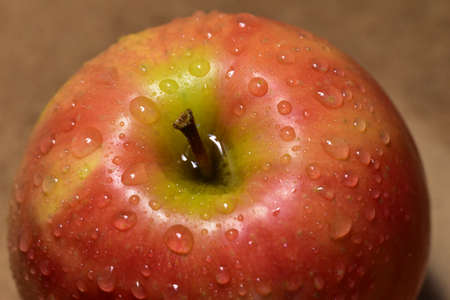 Apple is covered with water drops. Close-up of an apple.