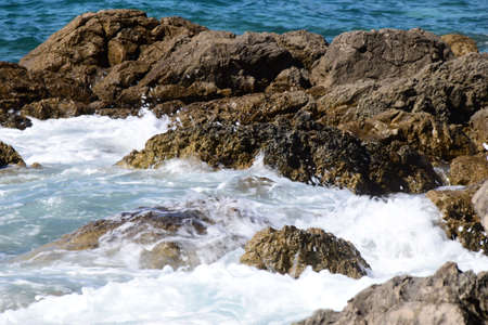 Water hitting the rocks.