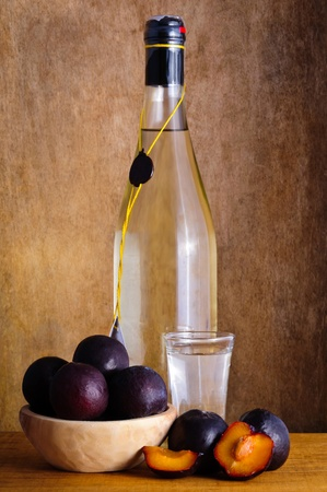 plums: Still life with traditional plum brandy