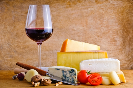 cheese platter: Still life composition with rustic snack food, cheese and red wine Stock Photo