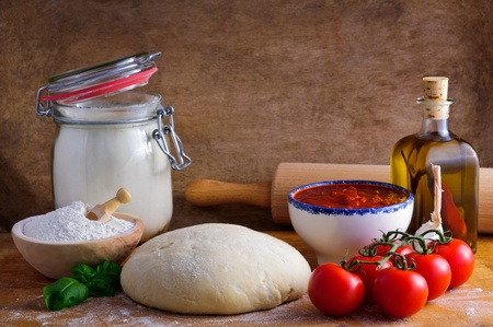 Traditional pizza dough and ingredients photo