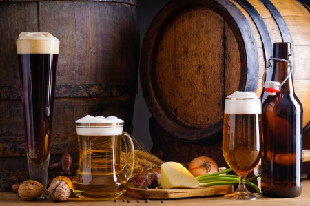 draught: Cellar still life with beer, traditional food and barrels Stock Photo