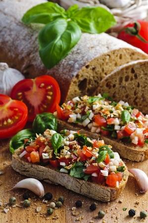 italian cuisine: delicious italian bruschetta with tomatoes, basil and garlic