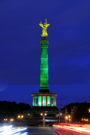 Victory column in Berlin at night photo