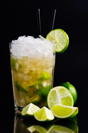 caipirinha: Caipirinha cocktail with limes on a dark background