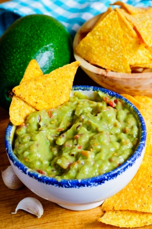 homemade traditional avocado guacamole and tortilla chips Stock Photo