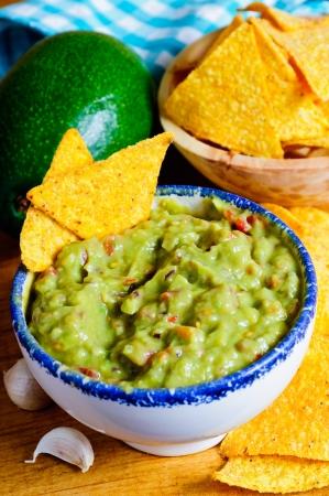 guacamole: homemade traditional avocado guacamole and tortilla chips Stock Photo