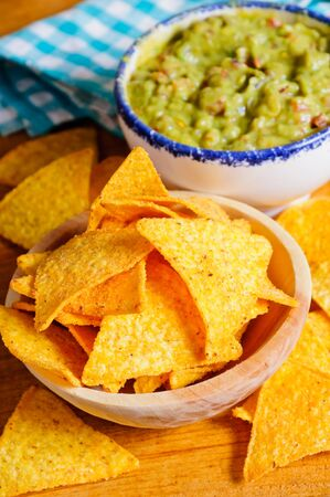nacho: Nacho chips with dip in background