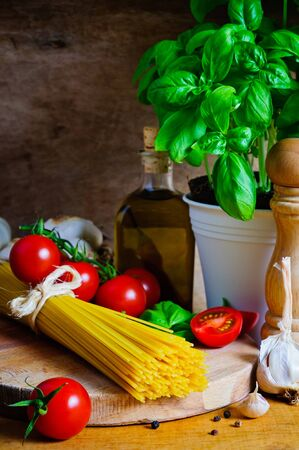 Still life with italian cooking ingredients for spaghetti photo