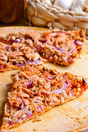 Slice of traditional tuna pizza with red onions Stock Photo - 13968880