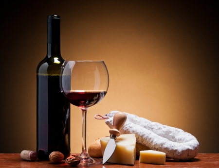 still life with red wine, italian hard cheese and traditional salami photo