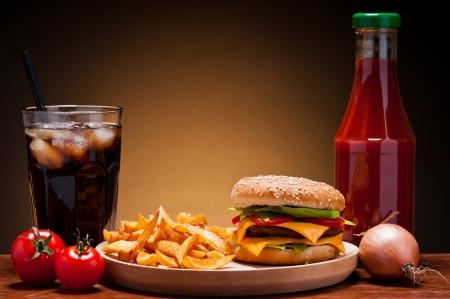 burger and fries: fast food hamburger menu with burger, french fries, cola and ketchup Stock Photo