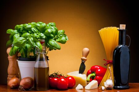 still life with traditional food ingredients for italian cuisine photo