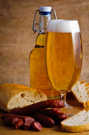 frankfurters: Still life with dried salami, beer and bread Stock Photo