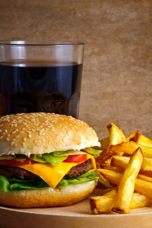 Closeup of cheeseburger menu with fries and cola Stock Photo